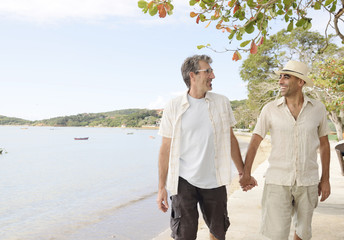 Gay couple on vacation holding hands