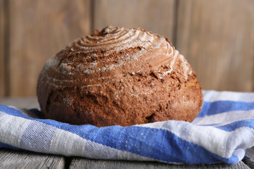 Fresh baked bread, on wooden background