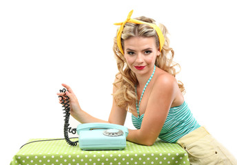 Beautiful girl with old telephone, on grey background