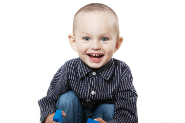 Smiling little boy on white