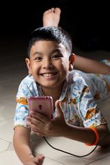 Bangkok, Thailand - September 4, 2014: Young kid stayed up late