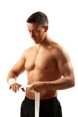 Handsome young muscular sportsman with with elastic bandage