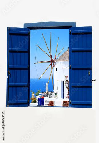 Open traditional Greek blue window on Santorini island, Greece