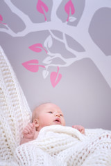 Cute baby in bedroom