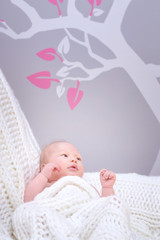 Cute little baby in bedroom