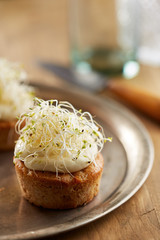 Individual carrot cake with sprouts