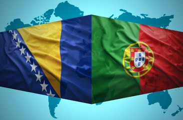 Waving Bosnian and Portuguese flags