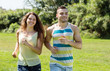 Happy young couple running outdoor