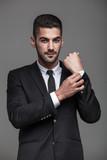 handsome elegant man on grey background