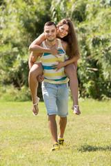 Girl and boyfriend in summer park
