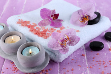 Orchid flowers, spa stones, candles and towel