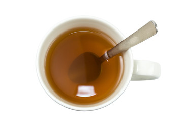 Closeup of a cup of tea with spoon viewed from above, isolated