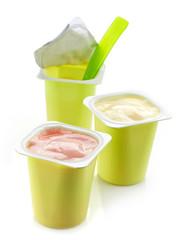 three plastic yogurt pots