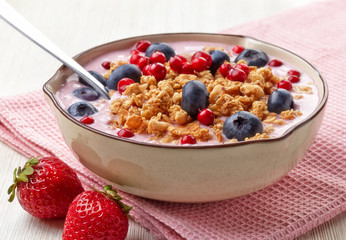Healthy breakfast. Yogurt with granola and berries