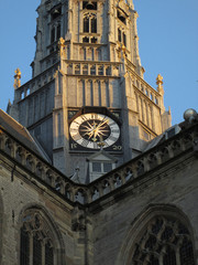 part of a church tower with the clock in the middle