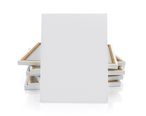 blank canvas or poster with pile of canvas on floor and wall