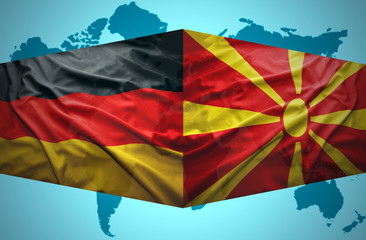 Waving Macedonian and German flags