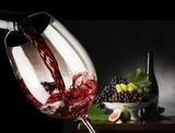 red wineglass with grapes - 70054714