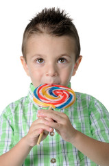 Blond boy with lollipop in her mouth