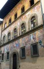 Old house, decorated with frescoes on the street in Florence