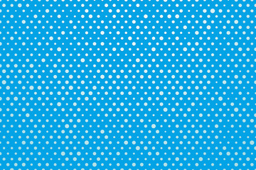 blue background with white polka dots