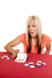 woman flipping over playing cards