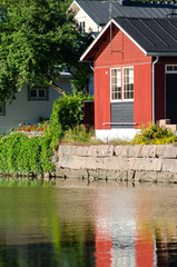 Porvoo, Finland. Old wooden red houses on the riverside