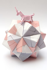 Origami unicorn riding paper ball