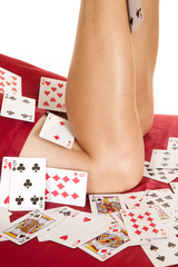 woman legs knees covered in cards