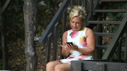 Woman Using a Smartphone outdoor