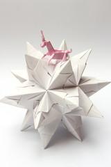 Origami unicorn riding paper star