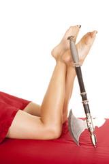 woman legs red sheet hatchet