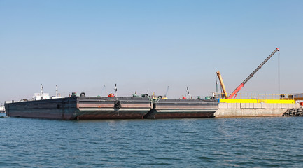 Loading of two cargo barges in Burgas port
