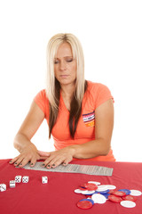 woman playing with cards laying them out