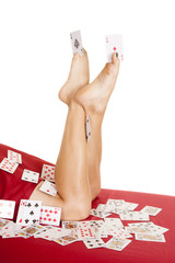 womans legs covered in cards aces in toes
