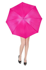 girl hiding behind a large pink umbrella