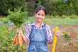 Girl with bunch of carrots