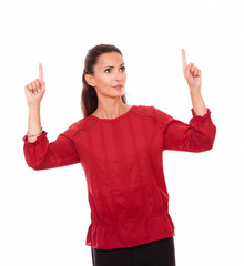 Charming latin female pointing up her fingers