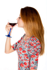 Beautiful young woman with alcoholic drink