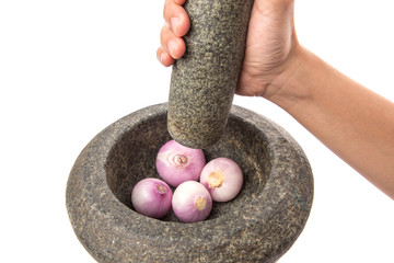 Crunching Onions Using Stone Pestle And Mortar