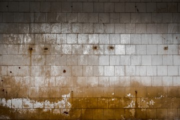 Old tiled wall of an industrial building
