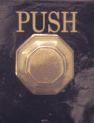 Detail of old vintage knob and push sign in UK