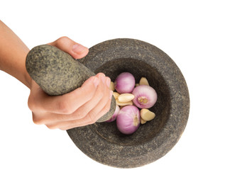 Crunching Onions And Garlic With Stone Mortar and Pestle