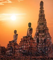 Stone statue of Buddha at sunset in Ayutthaya, Thailand