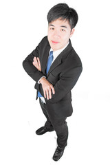 Asian young businessman stnading and arms crossed. Top view (cli