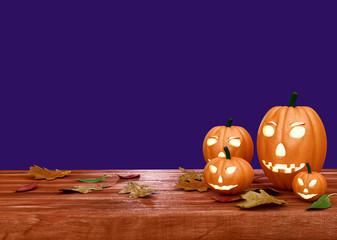 Halloween pumpkin lanterns on wooden desk