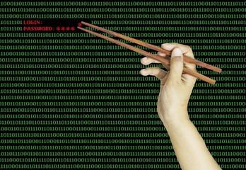 hand using chopsticks to pinch the last password on binary compu