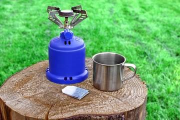 Camp Gas  Stove and steel tea mug.