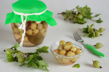 Bowl with marinated  gooseberries