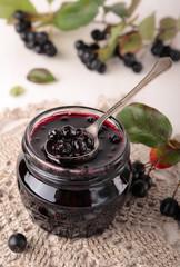 Spoon of black chokeberry jam
